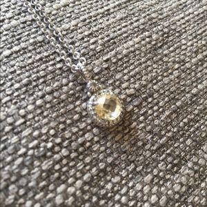 Silver pendant necklace yellow gem